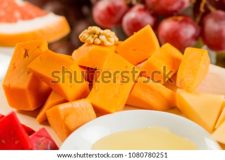 Pieces of cheese of different varieties, with honey #1080780251