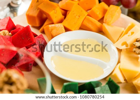 Pieces of cheese of different varieties, with honey #1080780254