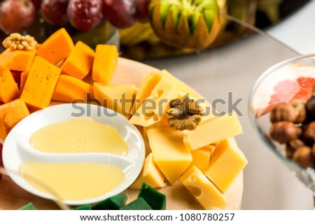 Pieces of cheese of different varieties, with honey #1080780257