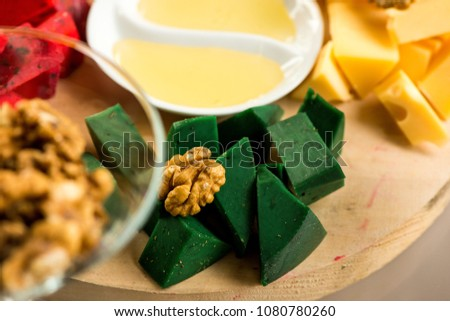 Pieces of cheese of different varieties, with honey #1080780260