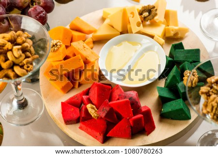 Pieces of cheese of different varieties, with honey #1080780263
