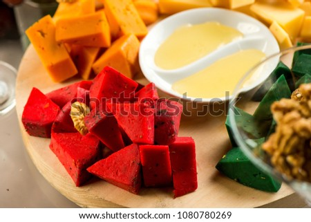 Pieces of cheese of different varieties, with honey #1080780269
