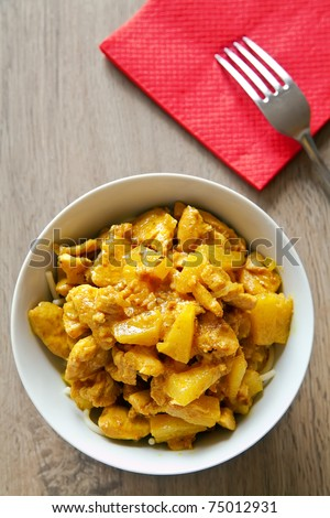 pieces of chicken and pineapples with curry sauce