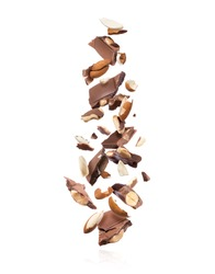 Pieces of chocolate bar with almonds falling down on white background