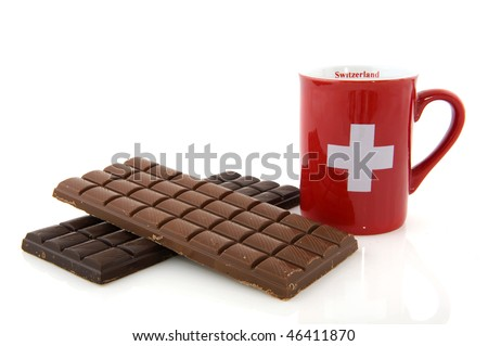Pieces of chocolate from Switzerland isolated over white