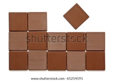 Pieces of chocolate on a white background