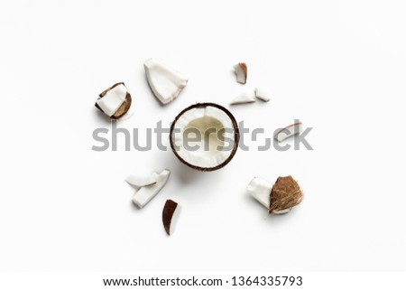 Pieces of coconut on white background, top view