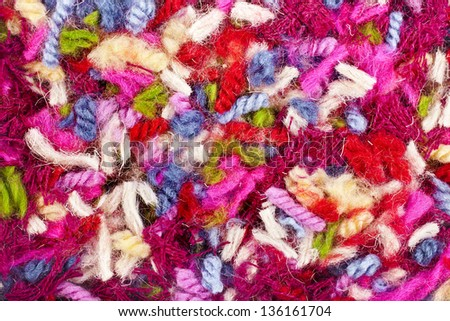 pieces of colored yarn threads background - stock photo