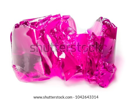 pieces of crimson jelly cut as flower. sweet jelly. ultra violet lilian pink berry sweet pieces of clean jelly isolated. Homemade Gelatin jelly Dessert in a Bowl. berry dessert for kids and adults