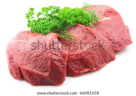 Pieces of crude meat with parsley and fennel
