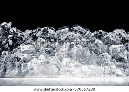 Pieces of crushed ice cubes on black background. Including clipping path. #578557288