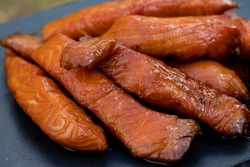 Pieces of cured and smoked maple candied salmon.