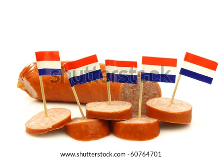pieces of cut smoked sausage with Dutch flag toothpicks on a white background