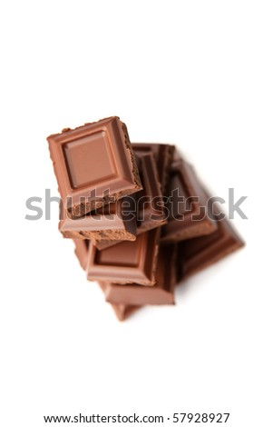 Pieces of dark chocolate stacked, view from above, isolated on white.