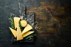 Pieces of delicious parmesan cheese and snacks. Rustic style. Free copy space.
