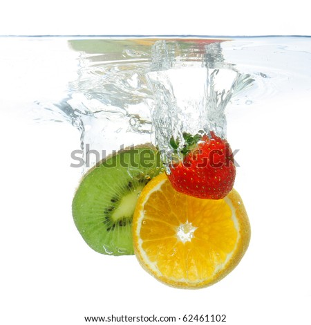 Pieces of different fruit dropped in water, isolated on white