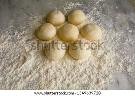PIECES OF DOUGH,pieces of dough divided into pieces before cooking, Stone table. close-up photo.