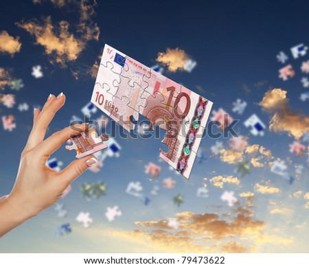 pieces of euro banknote puzzle getting together - Shutterstock ID 79473622
