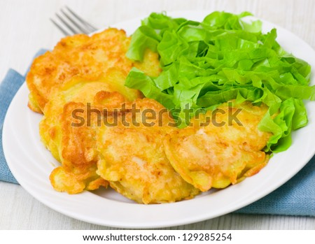 pieces of fish fillets in batter with salad