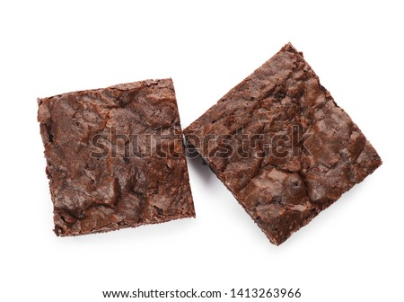 Pieces of fresh brownie on white background, top view. Delicious chocolate pie #1413263966