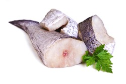 Pieces of fresh hake with parsley isolated