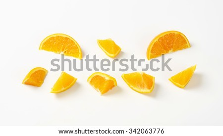 pieces of fresh orange on white background #342063776
