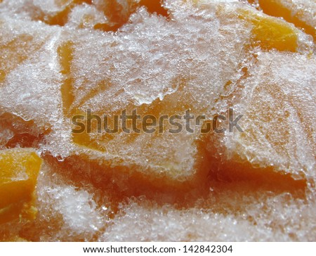 Pieces of frozen pumpkin (close-up)