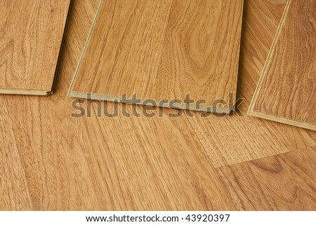 pieces of hardwood flooring showing tongue and groove