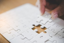 Pieces of jigsaw on palm,Pieces of jigsaw puzzle in man's hands
