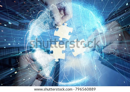 Pieces of jigsaw puzzle and global network concept.