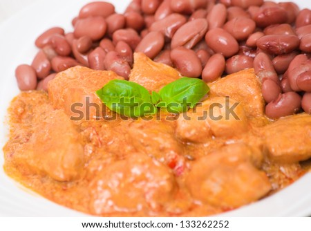 pieces of meat in sauce with red beans