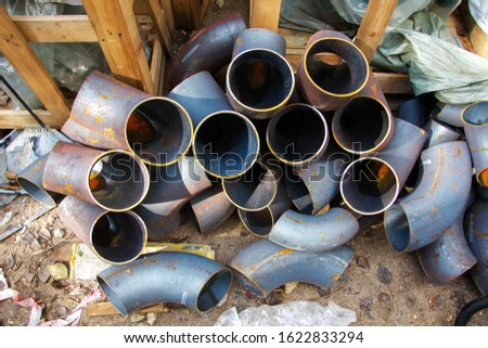 Pieces of metal pipes for pipeline installation. Close-up.