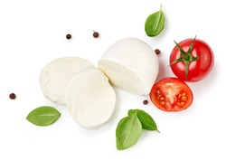 Pieces of mozzarella Buffalo cheese with basil leaves. Top view of sliced cheese with tomatoes isolated on white background.