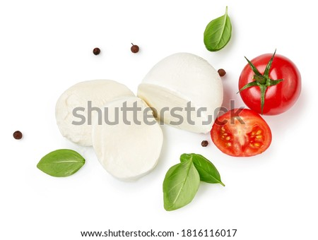 Pieces of mozzarella Buffalo cheese with basil leaves. Top view of sliced cheese with tomatoes isolated on white background. Zdjęcia stock ©