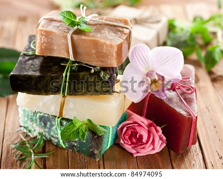 Pieces of natural soap with herbs and flowers.