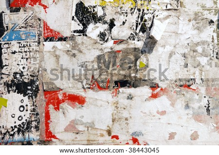 pieces of old posters on the wall - stock photo