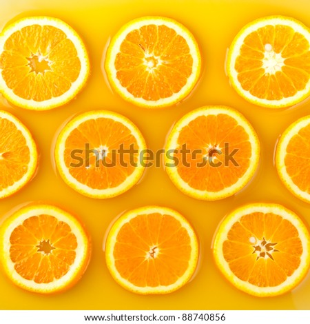 pieces of orange in orange juice - stock photo