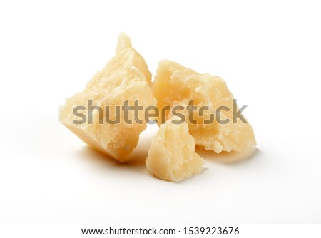 pieces of parmesan cheese isolated on white