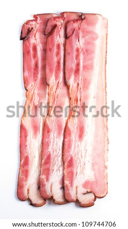 pieces of raw bacon isolated on a white background