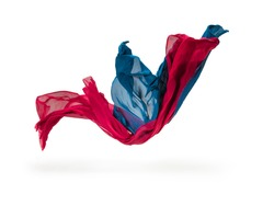 pieces of red and blue fabric flying, high-speed studio shot
