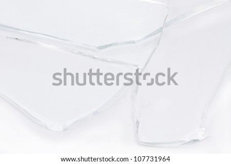 Pieces of smashed glass on white background