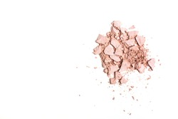 Pieces of smashed pink compact highlighter isolated on a white background. Space for text
