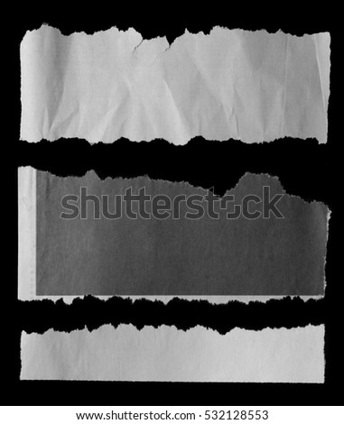 Pieces of torn paper on black #532128553
