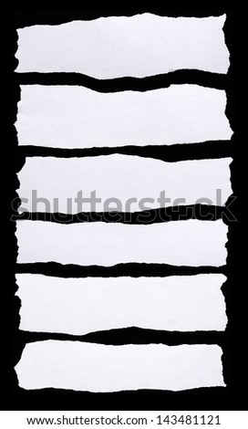 Pieces of torn white paper on black background. You can put your message on the paper