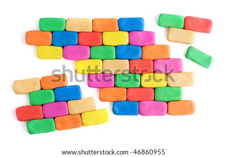 Pieces of wall made of colorful plasticine bricks