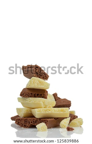 Pieces of white and dark porous chocolate