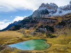 Piedrafita lake in Valley of Tena in Pyrenees with snowed Partacua mountains at background, Huesca, Spain.