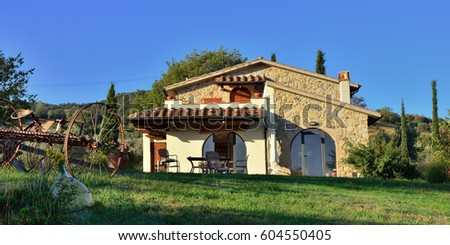 Pienza, Italy - Oct 08, 2012: Typical Tuscan old farmhouse. View on the facade from courtyard at sunrise