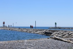 Pier along waterfront trail in Pickering, Ontario, Canada; Frenchman's Bay harbour entrance