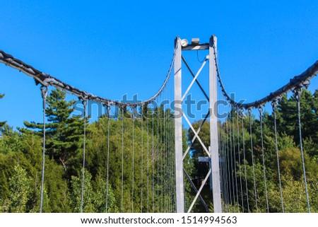 Pier and cable of suspension bridge, Gorge park, Coaticook, Quebec #1514994563